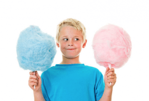 Boy with candy floss, blue candy floss and pink candy floss