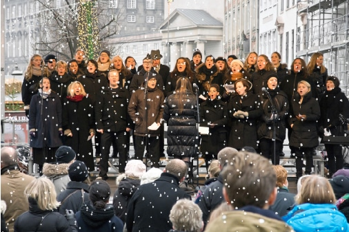 christmas choir in snow made from snow machine london